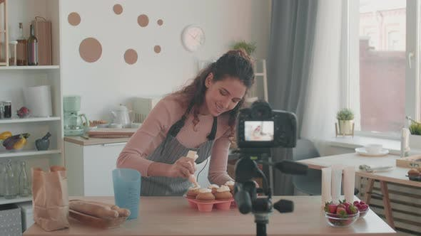 Thumbnail for Video Blogger Decorating Muffins for Tutorial