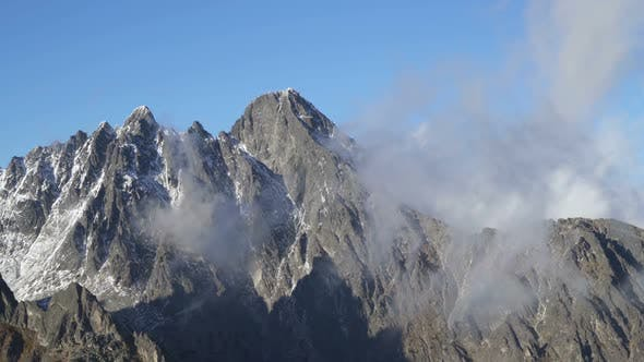 Cover Image for Clouds in Rocky Alps Mountains