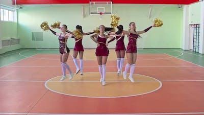 Group of Cheerleaders Dancing in Circle