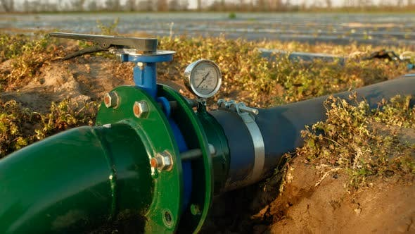 Irrigation Pipe System with Water Meter on Large Field