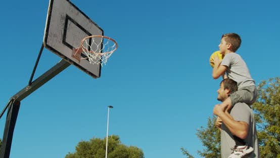 Thumbnail for Father and Son Playing Basketball.