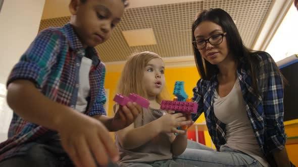 Thumbnail for Teacher with Diverse Kids Playing with Didactic Toys