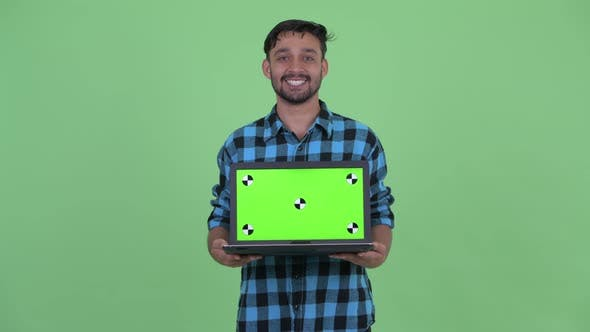 Thumbnail for Happy Young Bearded Persian Hipster Man Talking While Showing Laptop