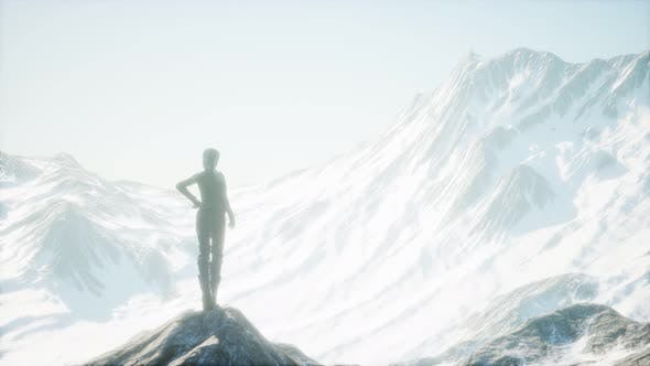 Thumbnail for Woman Standing In Snow Wearing Warm Clothes In Mountains