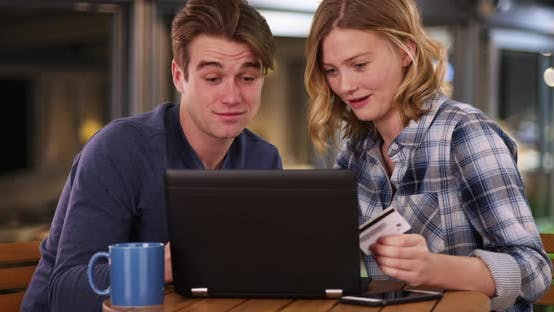 Thumbnail for Attractive young couple make online purchase with credit card