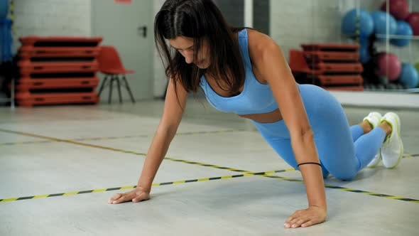 Thumbnail for Fitness Woman Training Push Up Exercise on Floor in Sport Club. Sporty Woman Pushing Up on Knees on