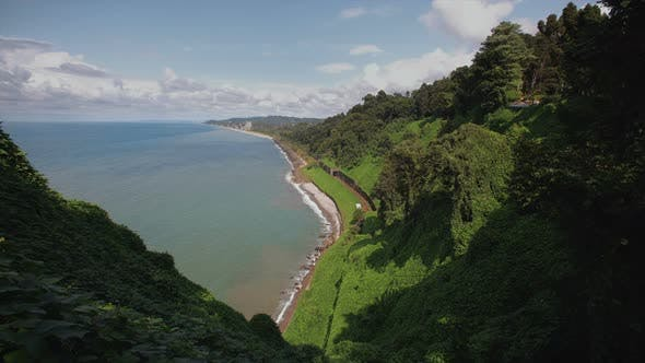 Thumbnail for Mountains with Tropical Trees Bushes, Cliff To Beach Railway Tracks and Tunnel Botanical Garden