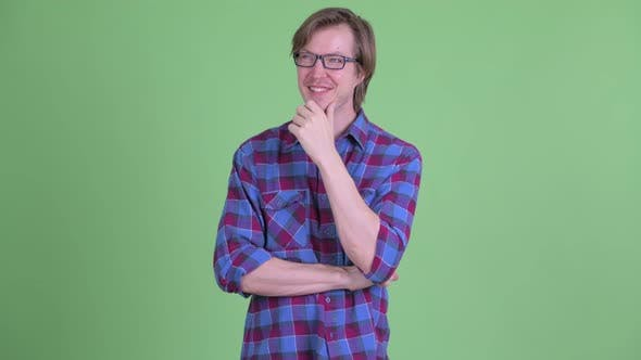 Thumbnail for Happy Young Handsome Hipster Man with Eyeglasses Thinking