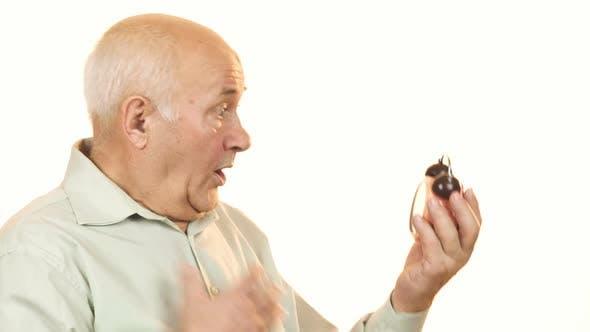 Thumbnail for Senior Man Looking Shocked Checking Time on Alarm Clock