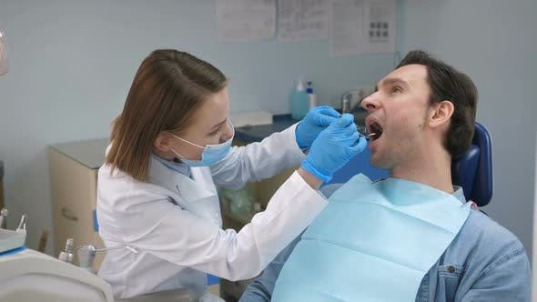 Thumbnail for Dentist Cheering Patient Before Check-up in Office