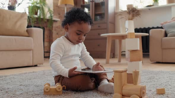 Black Toddler Boy Using Tablet