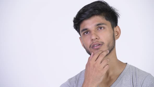 Thumbnail for Young Happy Bearded Indian Man Thinking While Looking Up