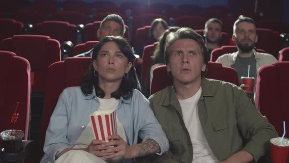People Watching Horror Movie in the Cinema