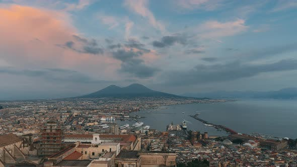 Naples, Italy. Top View Skyline Cityscape In Evening Lighting. Day To Night Transition