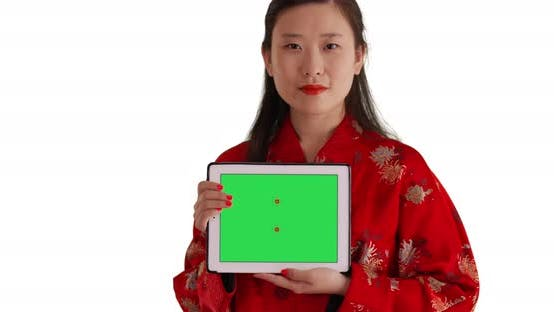 Thumbnail for Close up of Chinese woman showing tablet device screen for replacement on white