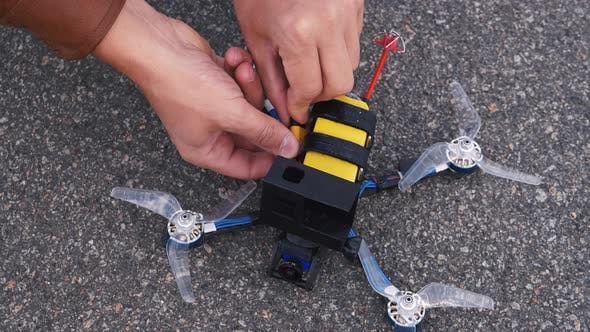 Thumbnail for FPV Drone Pilot Connects Battery To Drone