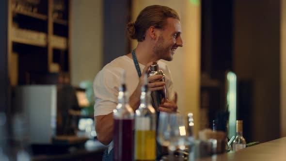 Thumbnail for Sexy Barman Mixing Cocktails at Counter
