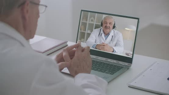 Thumbnail for Therapist and Surgeon Are Communicating and Consulting By Online Video Conference at Laptop
