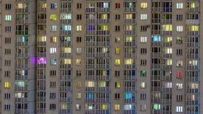 windows of residential buildings timelapse. light in the windows of apartments and apartments.