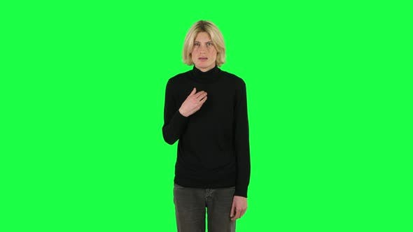 Cover Image for Blonde Guy Negatively Waving His Head Expressing He Is Innocent. Green Screen