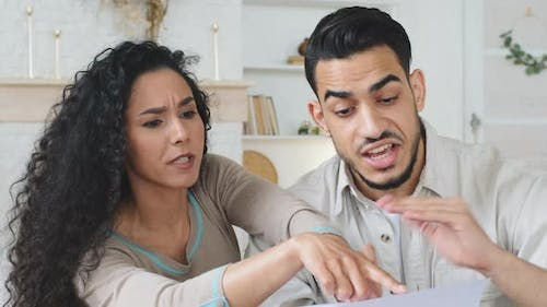 Hispanic Couple Sits at Home on Couch Hold Papers Receive Divorce Documents Letter with Bad News