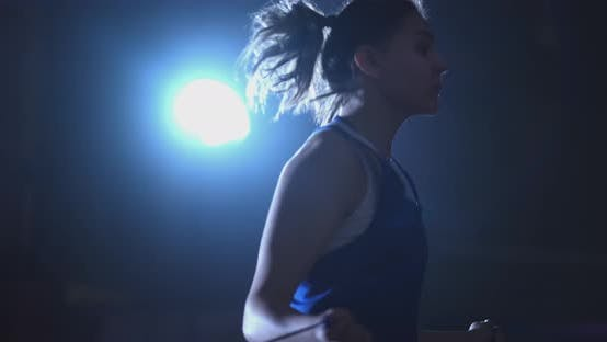 Thumbnail for Young Beautiful Woman Boxer in Training in the Hall Jumping Rope Close-up