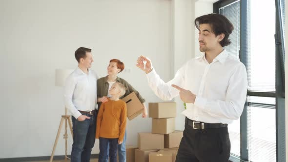 Family Couple Moving Into New Apartment Realtor Or Real Estate Agent Make Successful Work