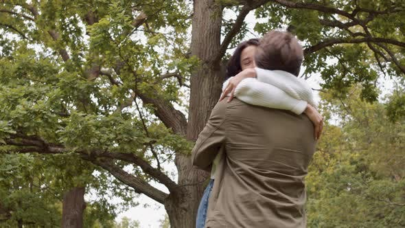 Thumbnail for Happy Couple Embracing in Park