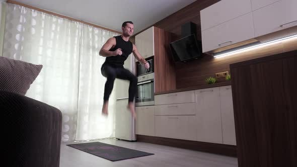 Thumbnail for A Man Performs an Endurance Exercise in a Home Environment