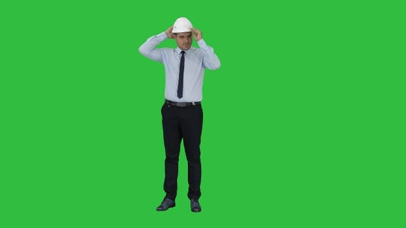 Thumbnail for Young construction worker in hard hat on gray background