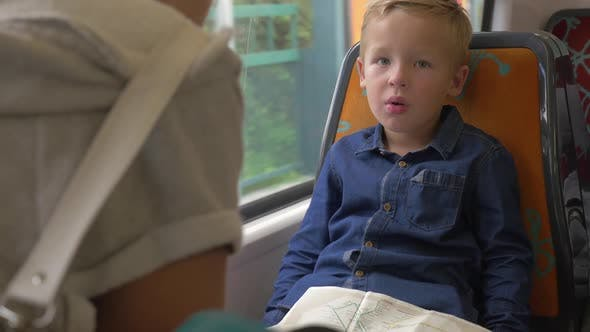 Thumbnail for Child with Map in Commuter Train