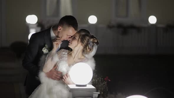 Thumbnail for Groom with Bride in Cold Evening on a Bridge Covered with Many Lanterns