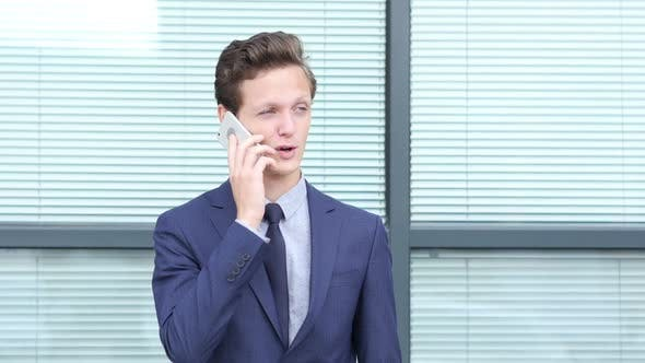 Thumbnail for Young Businessman Talking on Phone, Outdoor