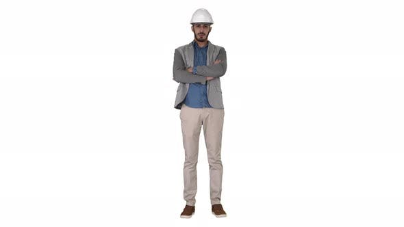 Thumbnail for Confident Construction Engineer Architect Young Man in Helmet with Hands Folded on White Background.