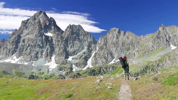 Thumbnail for slow motion: Woman trekking in idyllic mountain landscape on the alps