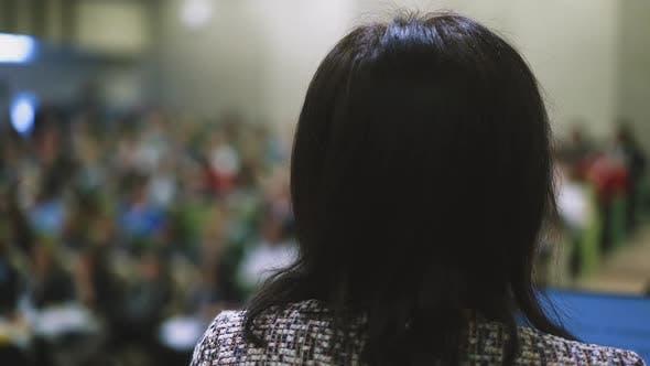 Brunette Woman in Jacket Ready for Haircut in Salon Closeup