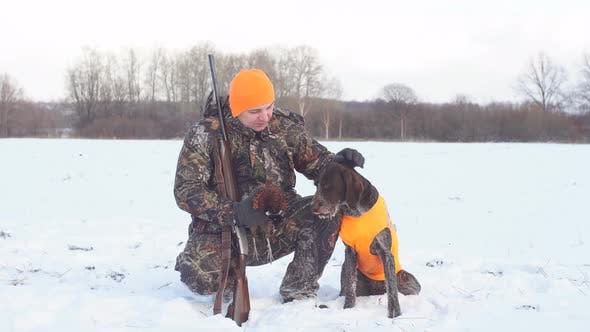 Thumbnail for Pleasant Man Is Thanking His Dog for Help During Hunting