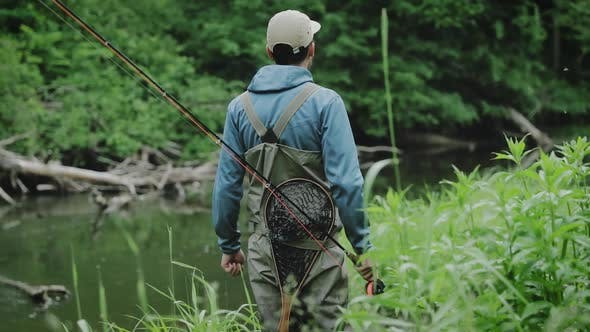 Thumbnail for Adventurous Fisherman Standing Near River