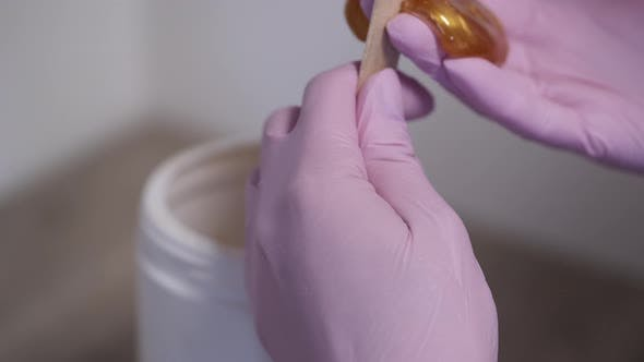 Thumbnail for Cropped View of Process of Taking Wax for Beautician Procedure