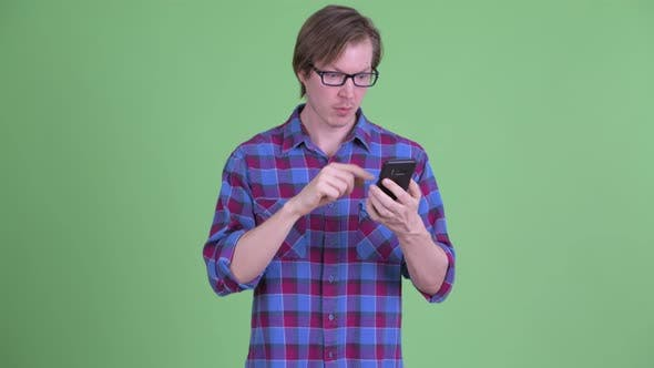 Thumbnail for Confused Young Hipster Man Using Phone and Shrugging Shoulders
