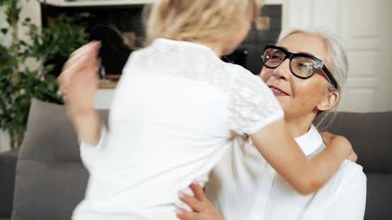 Thumbnail for Grandmother Hugging Granddaughter