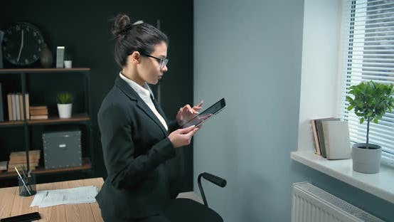 Thumbnail for Attractive Lady Using Digital Tablet at Office