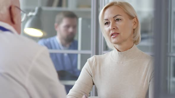 Thumbnail for Mid-Aged Female Patient Talking with Doctor