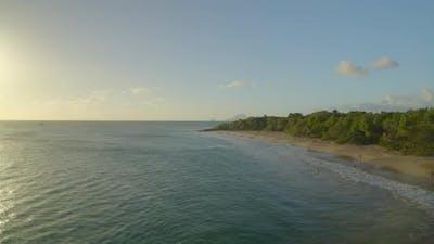 Tourist on seashore at sunset, Caribbean