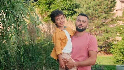 Portrait Of Mixed Race Father And Son Outdoors