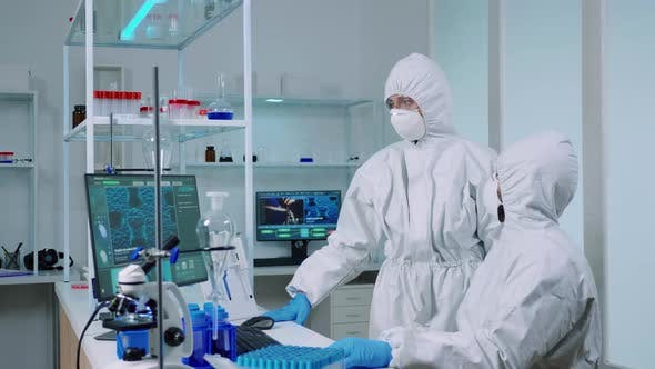 Thumbnail for Biotechnology Scientist Wearing Ppe Suit Researching