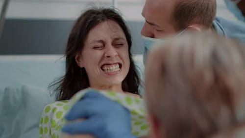 Close Up of Pregnant Woman Pushing and Screaming