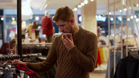 Thumbnail for Young Man Chooses Clothes and Talking on the Phone