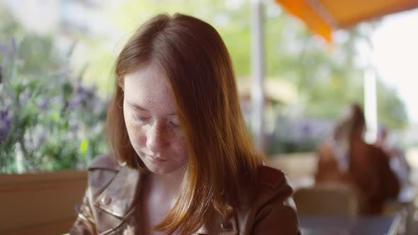 Thumbnail for Close up of Teenage Girl in Cafe