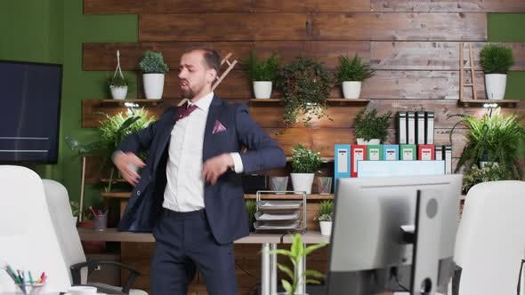 Thumbnail for Happy Corporate Worker Dances Alone in the Office